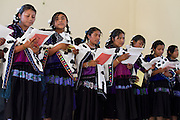 """The Acteal choir sings in migrants shelter """"La 72"""", during a homage to the victims of State violence in Mexico on October 14th, 2012. Mothers of central american migrants from Honduras, El Salvador, Guatemala and Nicaragua (claimed as disappeared in Mexico) will travel on a caravan from October 15t through 23 locations in 14 mexican states during 20 days. (Photo: Prometeo Lucero)"""