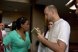04 Sept  2005. New Orleans, Louisiana. <br /> Post hurricane Katrina.<br /> Oprah Winfrey, US talk show host, visits the Hyatt Hotel in New Orleans as she prepares to survey the hurricane damage. Interviewed by reporter Ryan Parry.<br /> Photo Credit ©: Charlie Varley/varleypix.com
