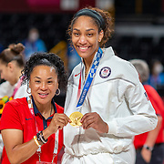 TOKYO, JAPAN August 8:  Head coach Dawn Staley of the United States with A'ja Wilson #9 of the United States with her gold medal at the medal presentation ceremony after the Japan V USA basket final for women at the Saitama Super Arena during the Tokyo 2020 Summer Olympic Games on August 8, 2021 in Tokyo, Japan. (Photo by Tim Clayton/Corbis via Getty Images)