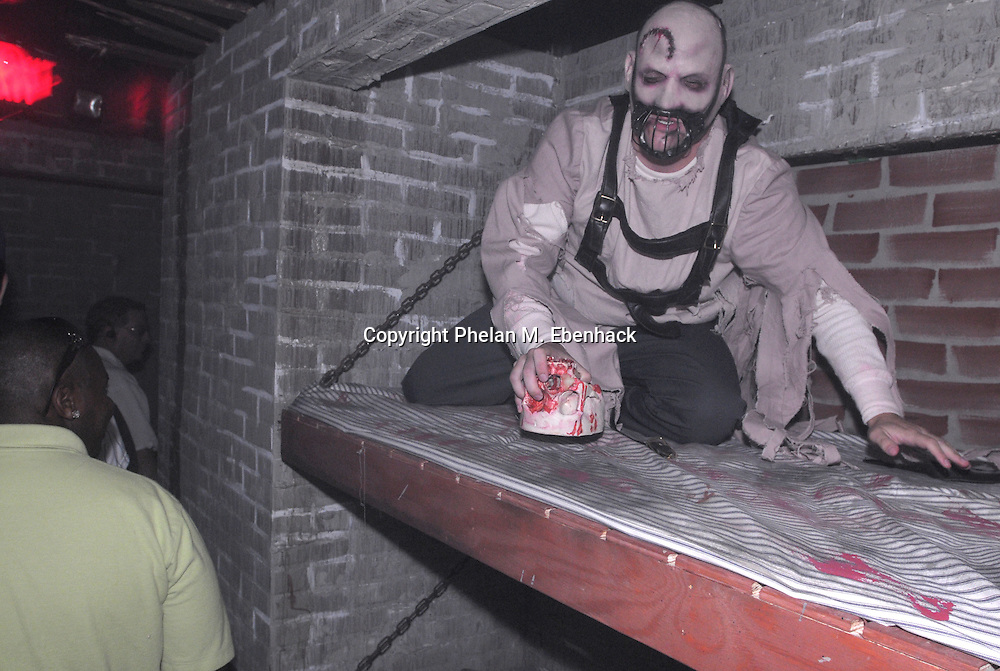 A ghoul jumps out from his sleeping area in the Body Collectors: Collections of the Past venue during a dress rehearsal of Universal Studios Florida's Halloween Horror Nights in Orlando, Fla., Tuesday, Sept. 16, 2008.