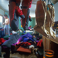 Inuit mukluks & modern mitts dry in a hunter's hut on Canada's Baffin Island, where an expedition is storm-bound for 4 days.