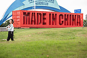 Sign made to look like a shipping container and reading Made In China at the China Guangdong Pilot Free Trade Zone exhibition center in Shenzhen, Guangdong province, China, on Tuesday, April 19, 2016. Once synonymous with Chinas manufacturing might, as the days of cheap land and labor recede, the provinces businesses are in a race to upgrade or move.