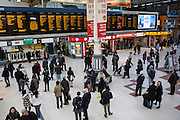 An elevated view of the main concourse of London Victoria railway station, United Kingdom.  The train station is located in central London and is the second-busiest in the capital. It connects the London Underground with the railway lines including the Gatwick Express to Gatwick airport.