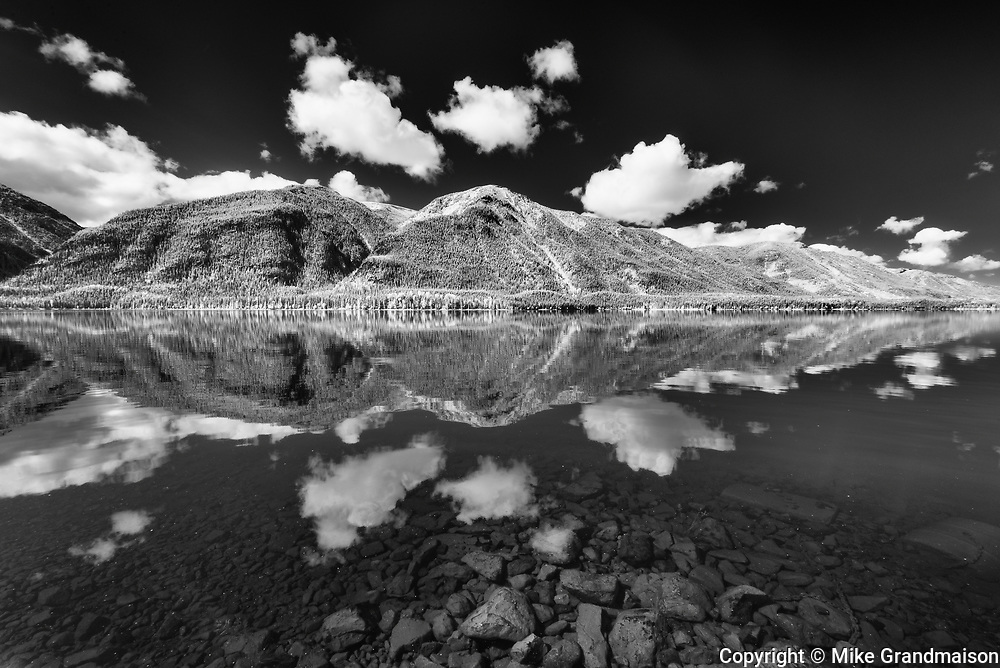 Clouds reflected in Muncho Lake and the Northern Canadian Rocky Mountains<br />Muncho Lake Provincial Park<br />British Columbia<br />Canada