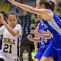 021914       Cable Hoover<br /> <br /> Chinle Wildcat Arianna Yazzie (21) charges past the Safford Bulldogs Wednesday at Chinle High School.
