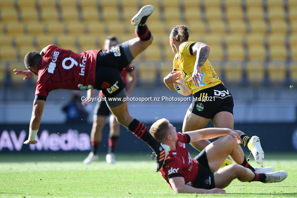 Hurricanes Peter Umaga-Jensen bowls through a tackle in the Super Rugby match, Hurricanes v Crusaders, Sky Stadium, Wellington, Sunday, April 11, 2021. Copyright photo: Kerry Marshall / www.photosport.nz