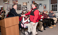 NHIAA's Pat Corbin awards Coach Craig Kozens with the National Federation of High School Coaches Association's Northeast Football Coach of the Year Tuesday evening.  (Karen Bobotas/for the Laconia Daily Sun)