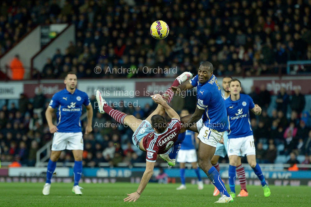 Andy Carroll of West Ham United attempts a bicycle kick with Wes Morgan, the Leicester City captain marking. Barclays Premier league match, West Ham Utd v Leicester city at the Boleyn ground, Upton Park in London on Sat 20th December 2014.<br /> pic by John Patrick Fletcher, Andrew Orchard sports photography.