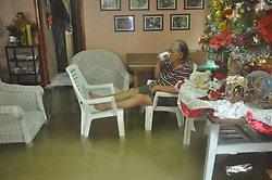 January 2, 2018 - Bais, Negros Oriental, Philippines - Woman sips coffee in her flooded living room. Tropical Depression Agaton hits, the first typhoon of the year. (Credit Image: © Joseph C. Ceriales/Pacific Press via ZUMA Wire)