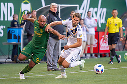 June 15, 2018 - Portland, Oregon, U.S. - PORTLAND, OR - JUNE 15: Portland Timbers forward Samuel Armenteros and LA Galaxy defender Dave Romney dispute a ball during the Portland Timbers game versus the LA Galaxy in a United States Open Cup match on June 15, 2018, at Providence Park, OR. (Photo by Diego G Diaz/Icon Sportswire) (Credit Image: © Diego Diaz/Icon SMI via ZUMA Press)