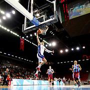 Anadolu Efes's Dario Saric (C) during their Turkish Basketball League match Anadolu Efes between Trabzonspor at Abdi Ipekci Arena in Istanbul Turkey on Sunday 19 October 2014. Photo by Aykut AKICI/TURKPIX