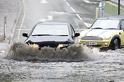 © Licensed to London News Pictures. 27/08/2020. Leatherhead, UK. Drivers make their way through floodwater in Leatherhead, Surrey after an hour of heavy torrential rain. Photo credit: Peter Macdiarmid/LNP