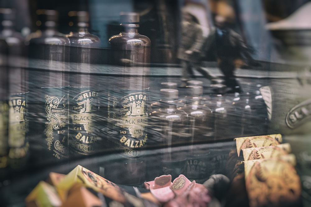 RIGA, LATVIA - CIRCA MAY 2014: Window reflections of the famous Black Magic Riga bar in Old Town