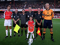 Tony Adams (Arsenal) and Sami Hyypia (Liverpool) meet the match officials and the mascot before the game. Arsenal v Liverpool. FA Premiership, 21/8/00. Credit: Colorsport.