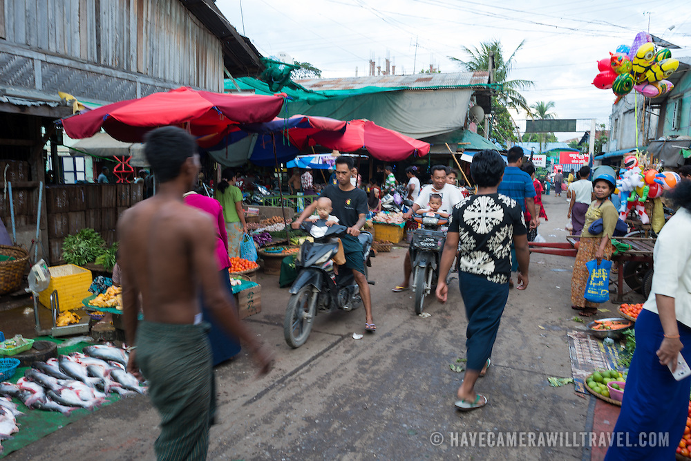 at the fish and flower market in Mandalay, Myanmar (Burma). Please note that this image has motion blur.