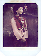 Lightpainting portrait of ethnic folk in Lijiang, Yunnan, China. Polaroid 79 out of date