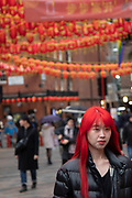 Chinese new year celebrations on Gerrard Street in Chinatown on 27th January 2020 in London, England, United Kingdom. Local Chinese community and Londoners gather on this famous area of central London which is the focus of celebrations for this, the Chinese Year of the Rat. Bright red lanterns are strung across between the buildings creating a canopy of colour.