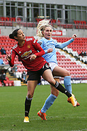 Manchester United forward Christen Press (24) and Manchester City midfielder Laura Coombs (7) during the FA Women's Super League match between Manchester United Women and Manchester City Women at Leigh Sports Village, Leigh, United Kingdom on 14 November 2020.