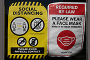 Notices asking members of the public to maintain social distancing and wear face masks in an attempt to reduce transmission of the Coronavirus on 1st July, 2021 in Batley, United Kingdom. As the British government ends legal requirements to wear face coverings and socially distance in England, some businesses and indoor spaces have maintained restrictions.