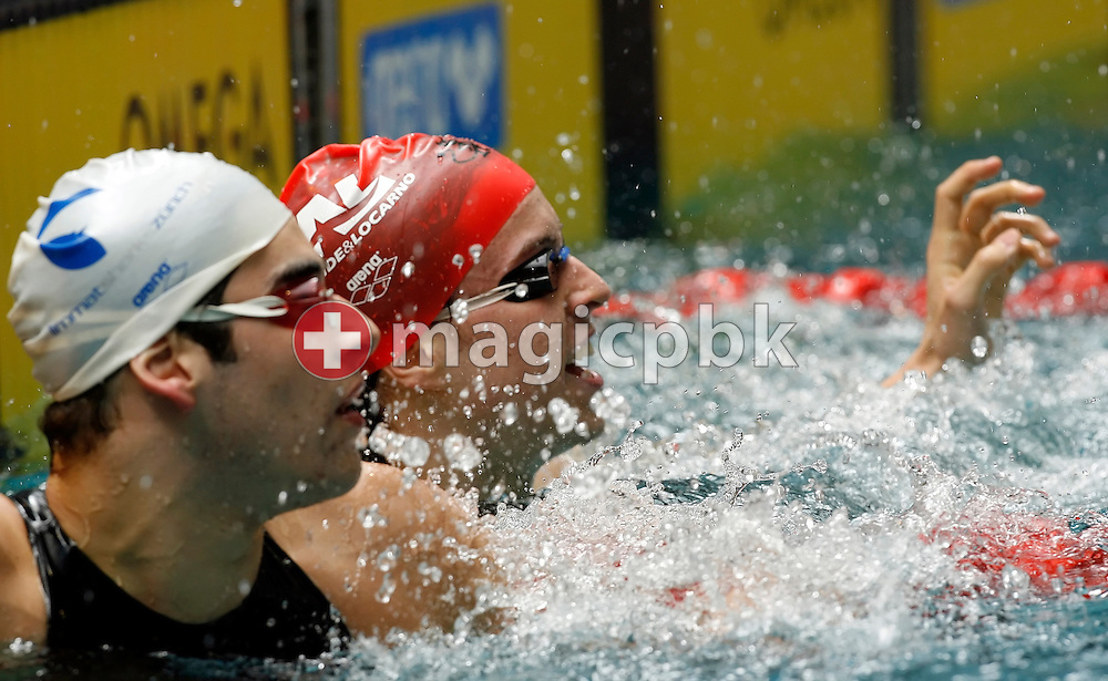 Eugenio Bianchi of Switzerland jubilates after taking over David Karasek (L) and finishing first in the men's 400m freestyle final in the Hallenbad Oerlikon at the Swimming Swiss Championships in Zurich, Switzerland, Thursday 10 May 2007. (Photo by Patrick B. Kraemer / MAGICPBK)