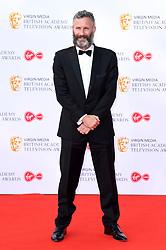 Adam Hills attending the Virgin Media BAFTA TV awards, held at the Royal Festival Hall in London. Photo credit should read: Doug Peters/EMPICS