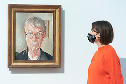 © Licensed to London News Pictures. 15/10/2020. London, UK. Self-portrait painting (1959) by artist Stanley Spencer is displayed as part of the Tate Britain's new collection displays inviting visitors to follow a route inside the venue. Photo credit: Ray Tang/LNP