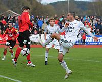 Fotball NM Cup Stjørdalsblink - Rosenborg<br /> Øverlands Minde, Stjørdal 13 mai 2010<br /> <br /> Alejandro Lago, Rosenborg fyrer mot Eirik Lerberg, Stjørdals-Blink<br /> <br /> Foto : Arve Johnsen, Digitalsport
