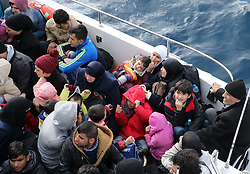 IZMIR, TURKEY - FEBRUARY 25: Syrian refugees, who tried to go to Greek Island Chios, are seen in a boat after they were caught  by Turkish Coast Guard ship TCSG Umut (Hope) near the Ciftlikkoy area in the Cesme district of Turkey on February 25, 2016.  Mahmut Serdar Alakus / Anadolu Agency  | BRAA20160225_427 Izmir Turquie Turkey