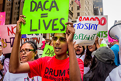 August 15, 2017 - New York, New York, United States - On the fifth anniversary of the Deferred Action for Childhood Arrivals (DACA) program, the New York Immigration Coalition will join its partners and immigrant New Yorkers to demand an end to discriminatory attacks on undocumented immigrant communities. Immigration advocates rally near Trump Tower on August 15, 2017; to demand Administration uphold programs that protect 1.2 million people from deportation. (Credit Image: © Erik Mcgregor/Pacific Press via ZUMA Wire)