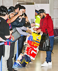 Dani Alves of FC Barcelona arrives at Manchester Airport with the squad ahead of the UEFA Champions League tie against Manchester City - Photo mandatory by-line: Matt McNulty/JMP - Mobile: 07966 386802 - 23/02/2015 - SPORT - Football - Manchester - Manchester Airport