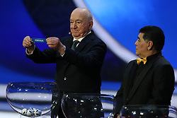 December 1, 2017 - Moscow, Russia - Draw assistant, Nikita Simonyan (L) draws Portugal during the Final Draw for the 2018 FIFA World Cup Russia at the State Kremlin Palace on December 1, 2017 in Moscow, Russia. (Credit Image: © Igor Russak/NurPhoto via ZUMA Press)