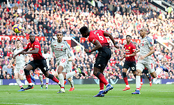 Manchester United's Paul Pogba (centre) heads towards the goal but sees his shot saved by Liverpool goalkeeper Alisson Becker during the Premier League match at Old Trafford, Manchester.