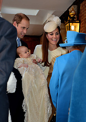 File photo dated 23/10/13 of Queen Elizabeth II speaking with the Duke and Duchess of Cambridge at Chapel Royal in St James's Palace, central London, with their son Prince George of Cambridge, on his christening day. The Duke and Duchess of Sussex's baby son Archie is expected to be baptised in the royal christening gown.