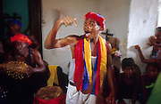 23 JULY 2002 - TRINIDAD, SANCTI SPIRITUS, CUBA: A Santeria ceremony in the colonial city of Trinidad, province of Sancti Spiritus, Cuba, July 23, 2002. Trinidad is one of the oldest cities in Cuba and was founded in 1514. Santeria is a blending of Catholicism, brought to Cuba by the Spanish and traditional African religions brought to Cuba by slaves imported by the Spanish. .PHOTO BY JACK KURTZ