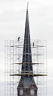 Workers from New York Ladder & Scaffold of Yonker erect scaffolding high on the First Congregational Church in Middletown on Tuesday, March 26, 2013. The church sustsained roof and steeple damage from Hurricane Sandy. The steeple will be reshingled and part of the roof repaired. The project is expected to take 6-8 weeks to complete.