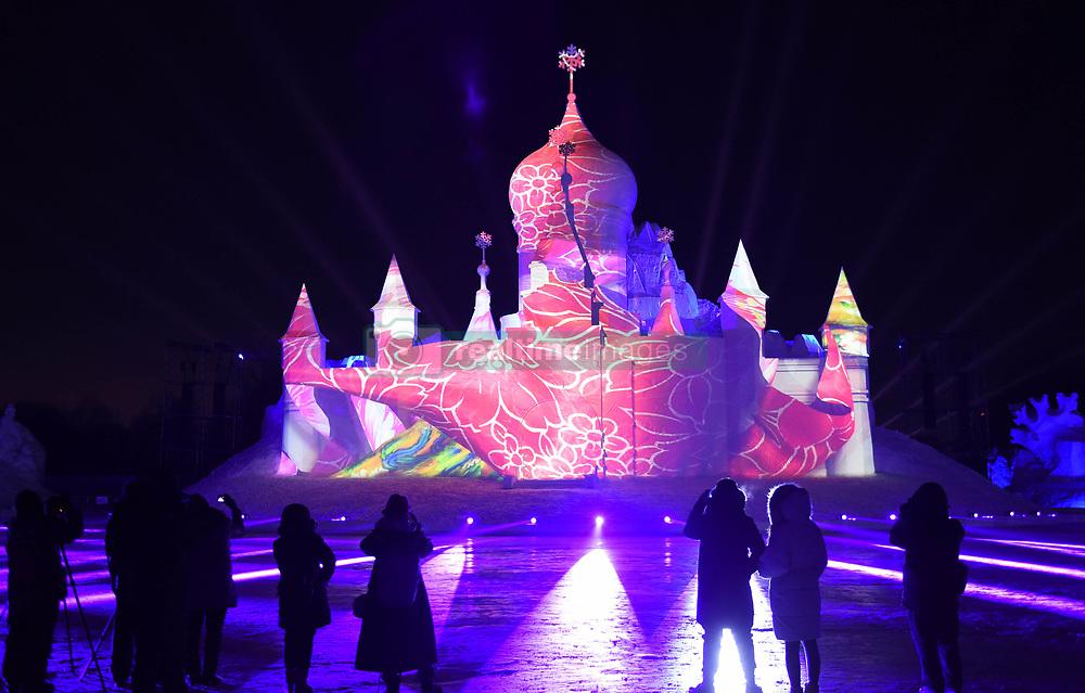 January 3, 2018  - Harbin, China - Tourists enjoy the show at the Sun Island International Snow Sculpture Art Expo in Harbin, capital of northeast China's Heilongjiang Province, Jan. 3, 2018. Snow Wonderland, a 3D snow-light show applying modern sound, light and digital technologies has been displayed at Sun Island International Snow Sculpture Art Expo recent days.  hxy) (Credit Image: © Wang Jianwei/Xinhua via ZUMA Wire)
