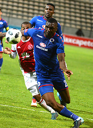 Cape Town 18-02-28 Ajax cape town player Fagrie Lakay attacking while Supersport defenders Morgan Gould and Azubuike Egwuekwe trying to defender in the PSL Game In Athlone Staduim Pictures Ayanda Ndamane African news agency/ANA