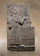 Photo of Hittite relief sculpted orthostat stone panel of Long Wall Basalt, Karkamıs, (Kargamıs), Carchemish (Karkemish), 900-700 B.C. Anatolian Civilisations Museum, Ankara, Turkey<br /> <br /> Goddess Kubaba. Goddess is depicted from the profile. She holds a pomegranate in her hands on her chest. She carries a one-horned headdress on her head. Her braided hair hangs down to her shoulder . <br /> <br /> On a brown art background. .<br />  <br /> If you prefer to buy from our ALAMY STOCK LIBRARY page at https://www.alamy.com/portfolio/paul-williams-funkystock/hittite-art-antiquities.html  - Type  Karkamıs in LOWER SEARCH WITHIN GALLERY box. Refine search by adding background colour, place, museum etc.<br /> <br /> Visit our HITTITE PHOTO COLLECTIONS for more photos to download or buy as wall art prints https://funkystock.photoshelter.com/gallery-collection/The-Hittites-Art-Artefacts-Antiquities-Historic-Sites-Pictures-Images-of/C0000NUBSMhSc3Oo