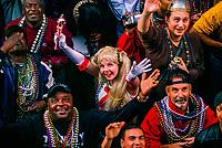 Mardi Gras revelers on Bourbon Street in the French Quarter, New Orleans, Louisiana USA