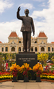 Statue of Ho Chi Minh with Hotel de Ville (Ho Chi Minh CIty Hall) behind, Ho Chi Minh City (Saigon), Vietnam