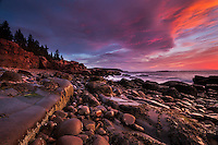 Exceptional colorful and dramatic sunrise light along the rocky coast of Acadia National Park in Maine.