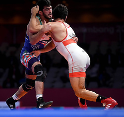 JAKARTA, Aug. 19, 2018  Hassan Yazdanicharati (L) of Iran celebrates after Men's Wrestling Freestyle 86 kg final against Domenic Michael Abounader of Lebanon at the 18th Asian Games at Jakarta, Indonesia, Aug. 19, 2018. (Credit Image: © Yue Yuewei/Xinhua via ZUMA Wire)