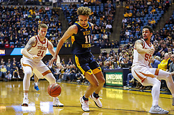 Feb 9, 2019; Morgantown, WV, USA; West Virginia Mountaineers forward Emmitt Matthews Jr. (11) makes move during the second half against the Texas Longhorns at WVU Coliseum. Mandatory Credit: Ben Queen-USA TODAY Sports