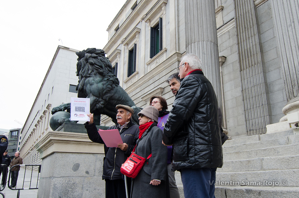 Julian Rebollo (L) at the Spanish Parliament gate holding a request for the historical memory to be deliver by the congressman Cayo Lara.