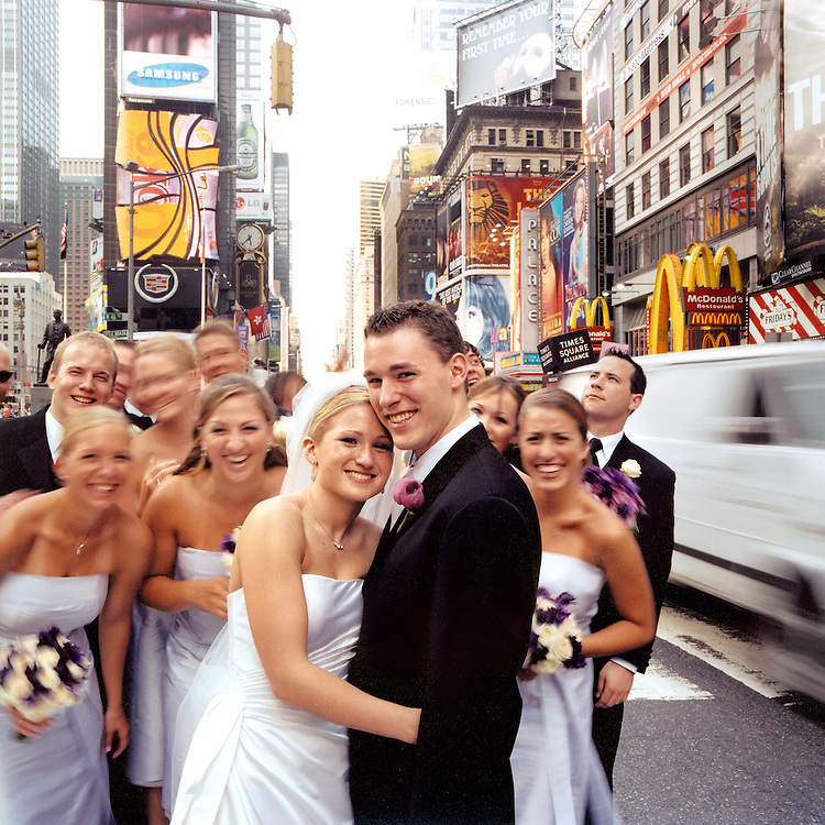 Wedding Bridal Party having fun posing for photograph in Times Square NYC