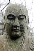 close up of an old and weathered Japanese Buddhist monument