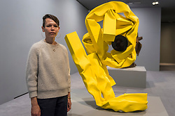 "© Licensed to London News Pictures. 07/06/2018. LONDON, UK. American artist Carol Bove poses with ""Nike II"", 2018, at the preview of an exhibition of her steel sculptures at the David Zwirner gallery in Mayfair.  The show runs 8 June to 3 August 2018.  Photo credit: Stephen Chung/LNP"