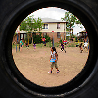 071113  Adron Gardner/Independent<br /> <br /> The busy playground at Fort Defiance Mission is viewed through a tire in Fort Defiance Thursday.