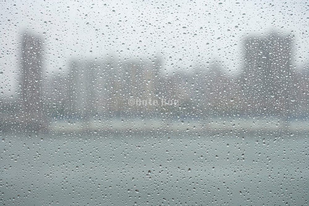 view of lower Manhattan through a window with rain drops