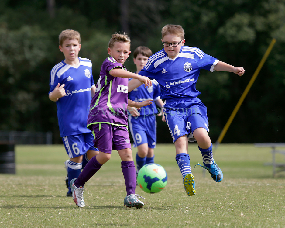 10 October 2015. Mandeville, Louisiana.<br /> New Orleans Jesters Youth Academy.<br /> U10 team purple take on Gulf Coast United (Blue). Jesters emerge victorious.<br /> Photo©; Charlie Varley/varleypix.com
